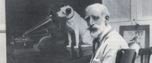 Francis Barraud with his painting of Nipper, the symbol for HMV