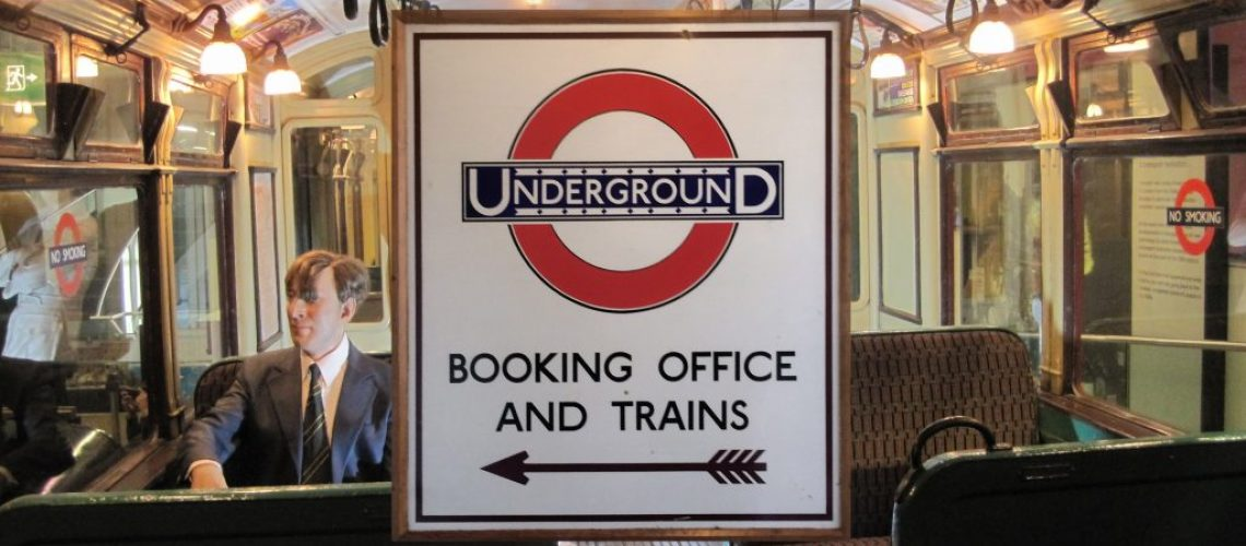 London Underground Booking office sign on background of 1960s Tube train
